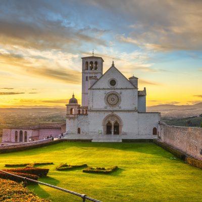 Assisi, San Francesco Basilica church at sunset. Umbria, Italy.