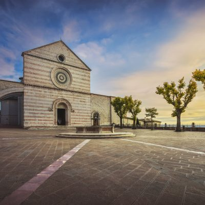 Assisi, Santa Chiara Basilica church at sunset. Umbria, Italy.