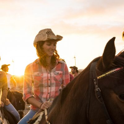 group of people riding on a horses together having fun and learning ride - walking on a horse
