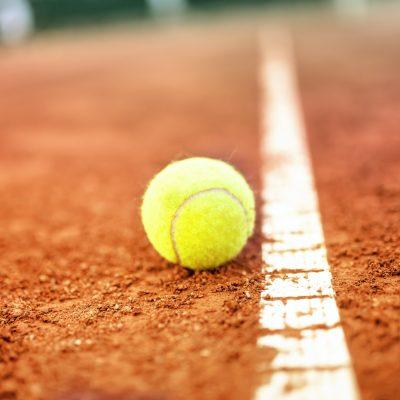 Tennis ball on a tennis clay court